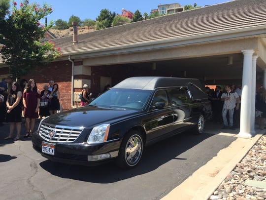 Family members gather around a Mitchell Funeral Home