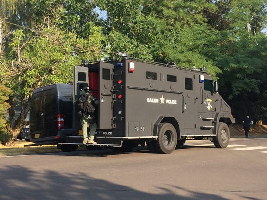 Keizer and Salem police work to take a man barricaded in his home into custody.