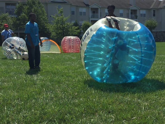 Emilia Trombi participates in Bump-n-Play Soccer at the Community Day at St. Andrews Apartments in Bear on Saturday.