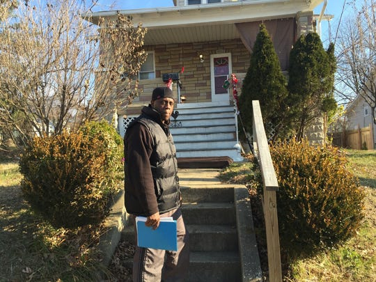 In this Dec. 28, 2016 photo, Robert Boyd stands outside his house in Baltimore. At 16, he was sentenced to life for his role in a home invasion that turned deadly. Boyd was the lookout, standing watch on the porch. The man who fired the fatal shot was acquitted at trial. In prison, Boyd earned degrees, stayed out of trouble, coached boxing. For years he unsuccessfully applied for parole. But in April 2016, after 34 years behind bars, he was released on probation after Johnston convinced a judge to reopen the case, arguing that Maryland's system didn't afford Boyd a meaningful chance at parole and was therefore unconstitutional. (AP Photo/Juliet Linderman)