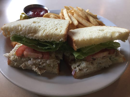 An albacore tuna salad incoporates sweet relish. Fries are hot and crisp.