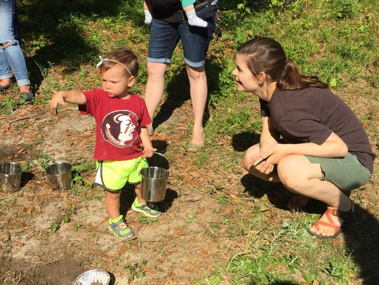 Children and adults interact during a Tinkergarten
