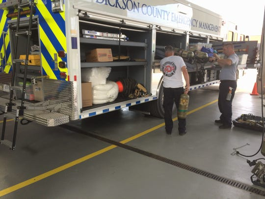 Dickson firefighters check equipment on the new Dickson