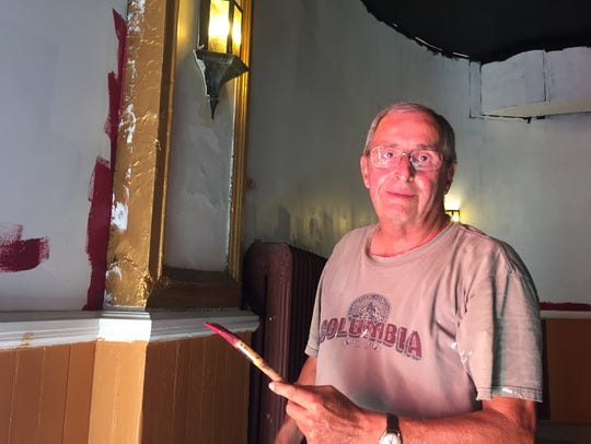 Doug Buchanan, a SORG volunteer, painting the theater
