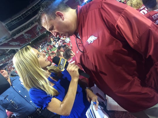 Dawn Davenport with Arkansas head coach Bret Bielema