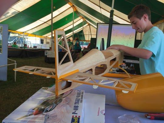 Peter Bellek, of Whitehouse, works on a model airplane