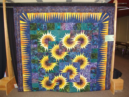 This is just one of the more than 200 quilts on display this weekend as part of the annual  Coshocton Canal Quilters quilt show. The theme of this year's show is Quilting Creatively - One Shape at a Time.