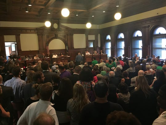 An overflow crowd packed the Rochester City Council