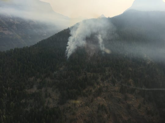 The Sprague fire burns in Glacier National Park earlier this summer.