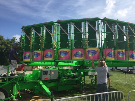 Bates Amusement employees assembled and inspected rides in preparation for the midway opening at Muskingum County Fair.