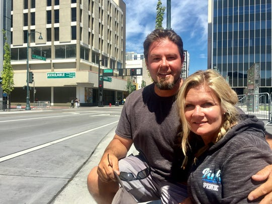 Beau Kimbrough, 41, and his wife Casey Kimbrough, 43, sit on the sidewalk along South Virginia Street following the Hot August Night parade finale on Aug. 13, 2017.