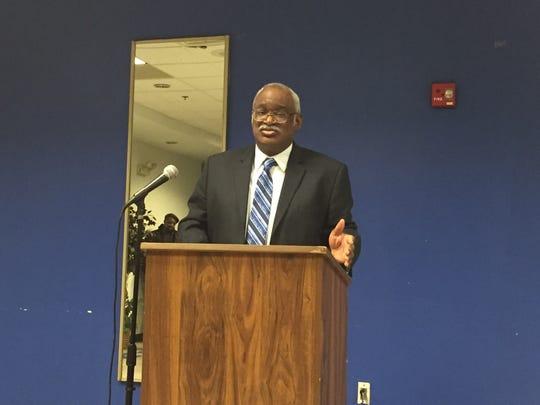 City Councilman Samuel L. Guy leads a meeting regarding prayer at council meetings.