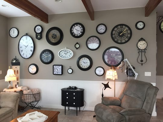 Clocks dominate one wall of the family room.