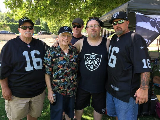 Some of the Reno-area Oakland Raiders fans forming