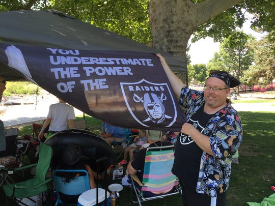 Willie Puchert displays one of his Oakland Raiders flags.