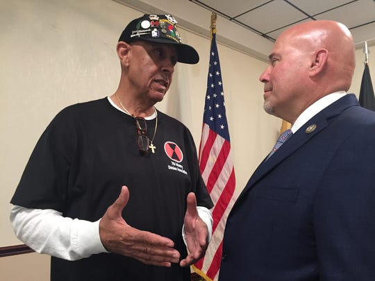 Rep. Thomas MacArthur, R-N.J., chats with  Army  veteran Garfield Harper Jr. of Westampton in Pemberton Tuesday. The congressman is sponsoring legislation to help veterans like Garfield  who developed health issues after exposure to the chemical Agent Orange in or near the Demilitarized Zone in Korea in 1967-68.