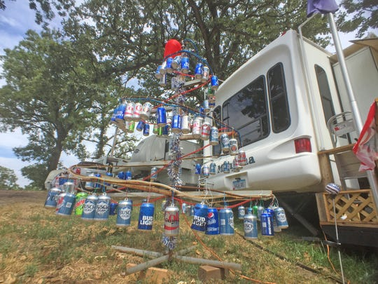 Welcome to the Iowa State Fair campgrounds and Christmas in August courtesy of the Puls family's beer-can tree.