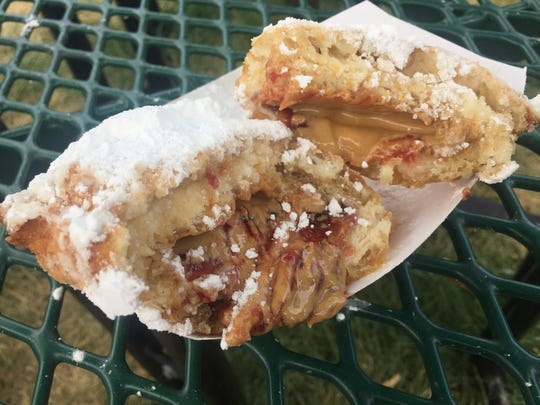 Molten peanut butter drips from the deep-fried peanut butter and jelly sandwich at the 2017 Indiana State Fair.