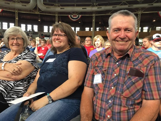 Vern Blazek of rural Orient, right, sits in the front row Thursday during the ceremony to honor Century and Heritage Farms held inside the Livestock Pavilion.