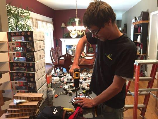 George Gulya, 22, an apprentice with GenRenew, works
