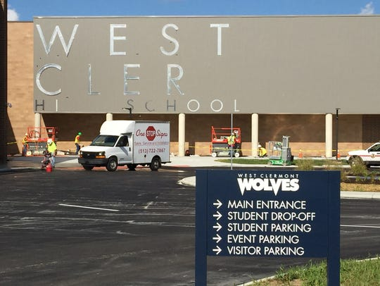 Workers put up lettering on the new West Clermont High