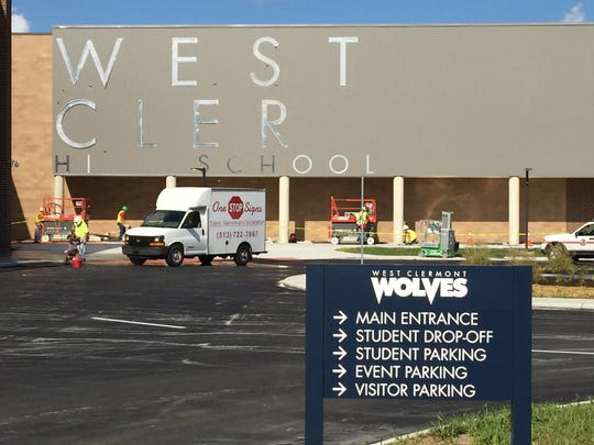 Workers put up lettering on the new West Clermont High School ahead of its opening on Aug. 30 and dedication day Aug. 25.