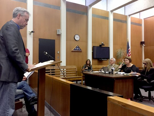 Thomas LaDuke, left, addresses the Macomb County Election Commission on August 17, 2017 on recall petition language he filed against Fraser Mayor Joseph Nichols.