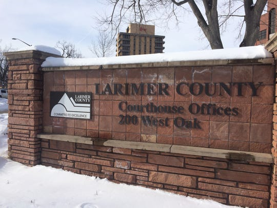 The sign outside the Larimer County Courthouse