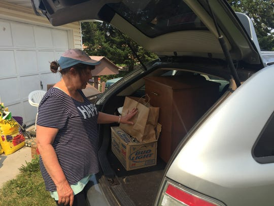 Gail Compton of Lolo loads up belongings in case she