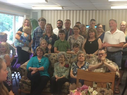 Members of Lenore Ehlert's family gather for a portrait at her 100th birthday celebration Saturday in Merrill.