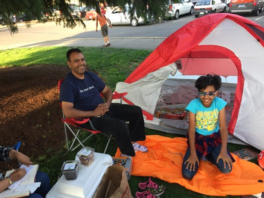 Selly Beyene (right) and her father, Yard Beyene, were among the first people to set up their tent at Riverfront Park in Salem, Ore. on Saturday.