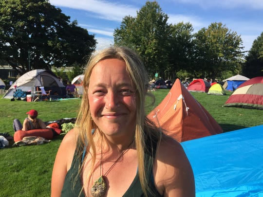 Sarah Witts, of Cornwall, England is among dozens of people camping at Riverfront Park Sunday in advance of Monday's Great American Eclipse.