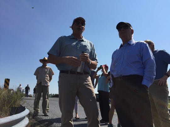 U.S. Sen. Ben Cardin of Maryland views a marsh restoration