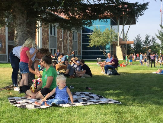 Entire families headed outdoors Monday to look through