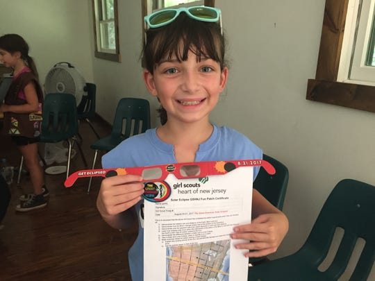 """With millions of people including Julia Petersen, 9, of Hillsborough in the path of the """"Great American Eclipse,"""" locally, the Bridgewater branch of the Somerset County Library System of New Jersey (SCLSNJ) drew about 300 while a viewing event at the Raritan Valley Community College in Branchburg had more than 2,000 attend. GSHNJ had 15 Girl Scouts along with about 20 adults at their program. Participants from GSHNJ's special eclipse programming earned the """"Solar Eclipse GSHNJ Fun Patch"""" and certificate as they kicked off the STEM-inspired """"Reaching for the Stars: NASA Science for Girl Scouts"""" program."""