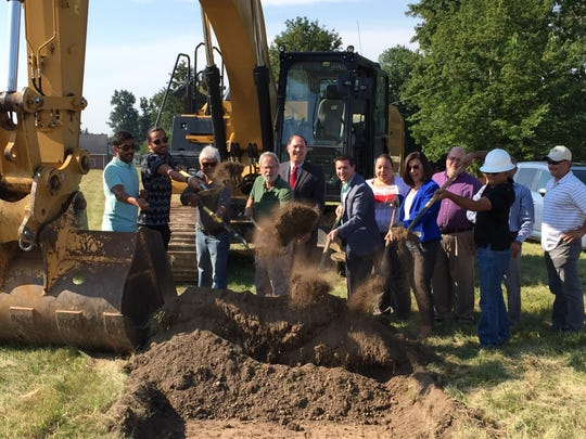 Officials break ground for a new Valero 24 Store in Shelby on Monday.