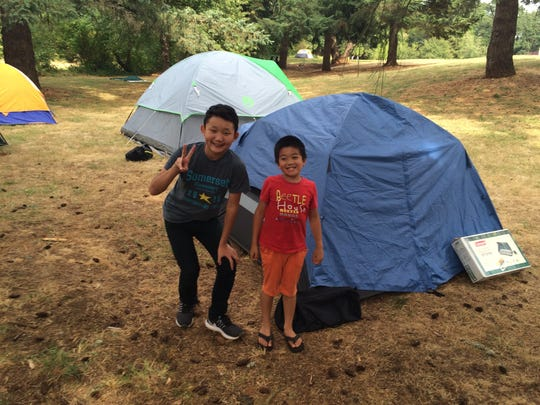 Christopher Shang (left) and his friend, Austin He, camp out Sunday afternoon at Woodmansee Park in South Salem ahead of Monday morning's eclipse.
