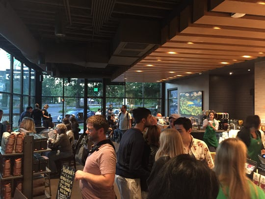 The Starbucks at Church and Ferry streets was packed Monday morning.