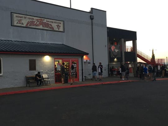 Fans enter the Volcanoes Stadium at 6 a.m. for the first Eclipse Game in baseball history