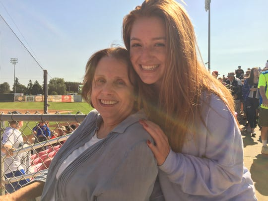 Chase Schechter and her grandmother, Joan Bouchard, minutes after the total solar eclipse at Volcanoes Stadium.