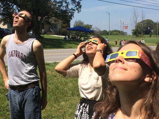 Eclipse enthusiasts watch the beginnings of the solar