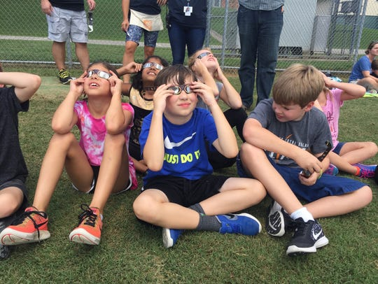 Lipscomb Elementary School students press solar glasses