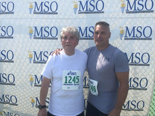 Diego Enciso, 84, of Brighton, with his son, Matt Enciso, 53, of Highland. The pair competed in their respective age groups at the Michigan Senior Olympics on Sunday, Aug. 20, 2017 at the Oakland University campus.