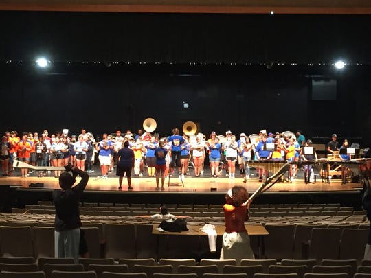 Millville High School's Marching Thunderbolts practice at Lakeside Middle School during their preseason camp.