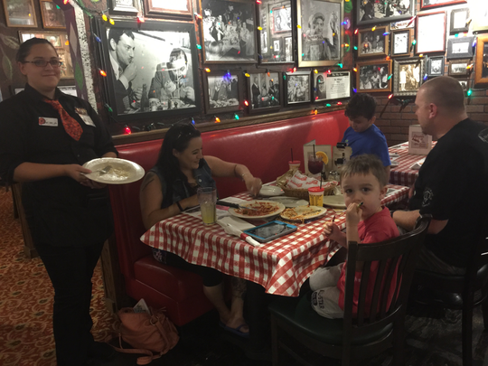 The Laudon family enjoys a night out at Buca di Beppo at Southridge Mall in Greendale. Service provided by Kim Otto.