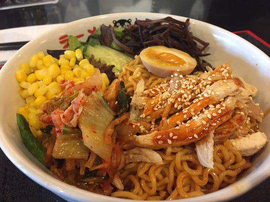 A bowl of bibim noodles at Ramen Kumamoto in downtown Newark. The $11 dish includes fresh cold spicy noodles, chicken, kimchee, corn, black mushroom ears, cucumber and a soft boiled egg.