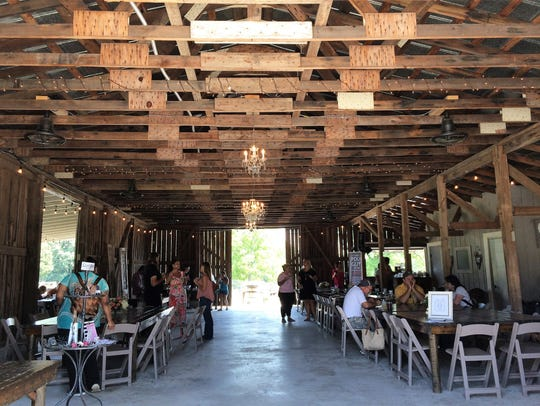 The former cattle barn was restored and converted into