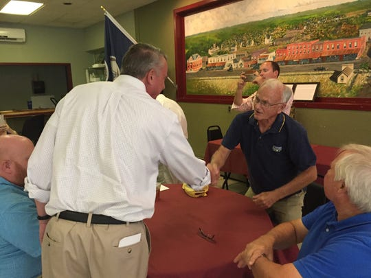 Republican candidate for Virginia governor Ed Gillespie greets Mayor James Eichelberger at the Club Car Cafe in Parksley, Virginia during a campaign stop on Wednesday, Aug. 23, 2017.