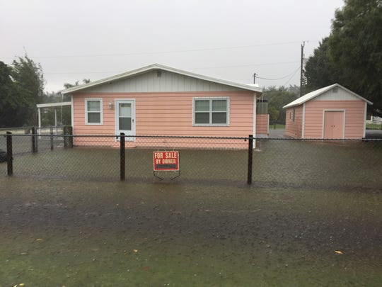 A house sits with water up to the doors Friday off