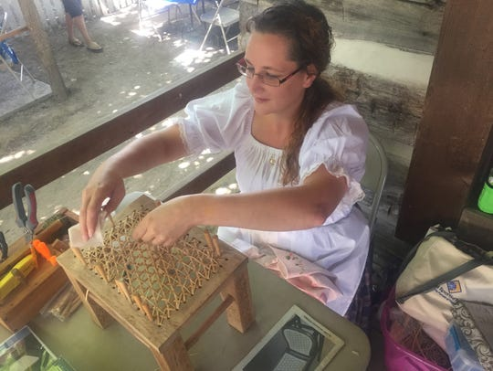 Celena Smith of Lindsey repairs a footstool Friday